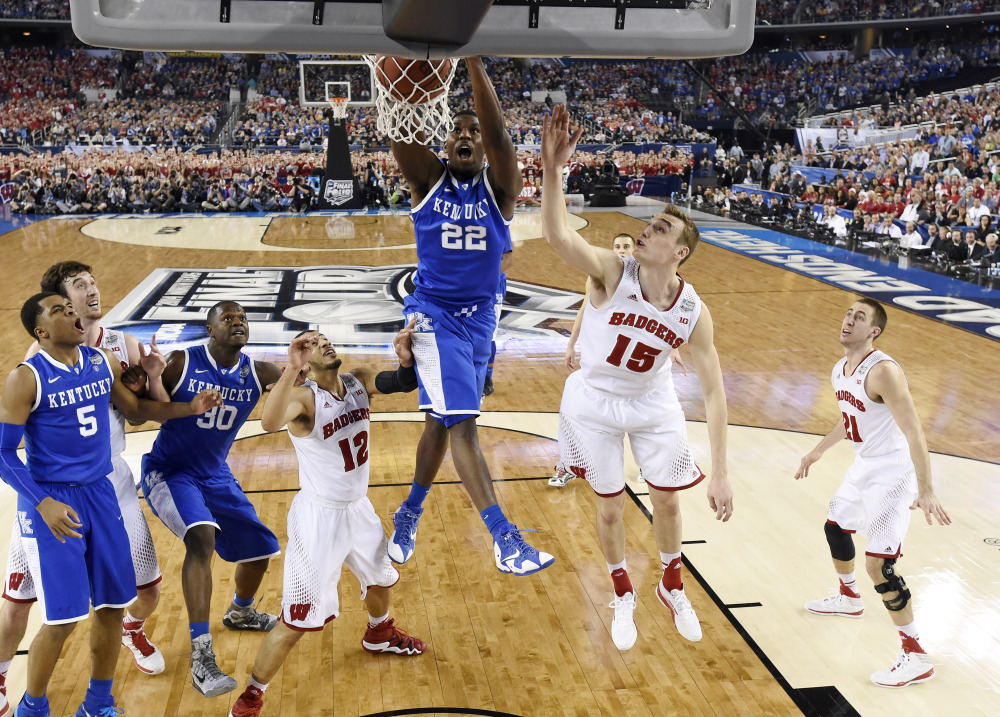 Kentucky forward Alex Poythress (22) dunks against Wisconsin during the second half of the NCAA Final Four semifinal game Saturday in Arlington, Texas.