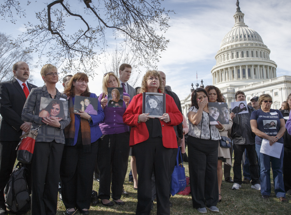 Families of victims of a General Motors safety defect gather at Capitol Hill in Washington on April 1.
