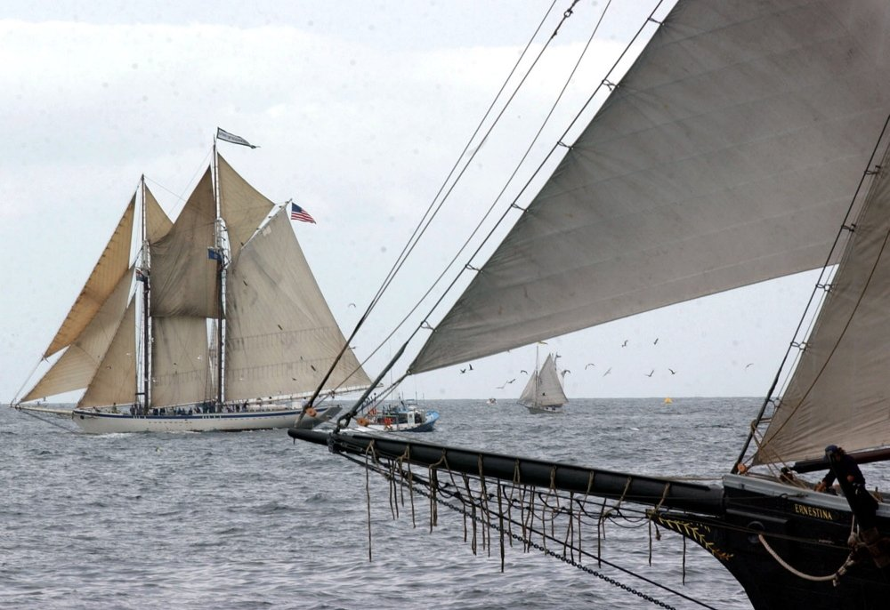 The schooner Spirit of Massachusetts, left, races at an annual Gloucester Schooner Festival off the coast of Gloucester, Mass. It is one of three traditional schooners owned by Ocean Classroom Foundation, based in Portland.