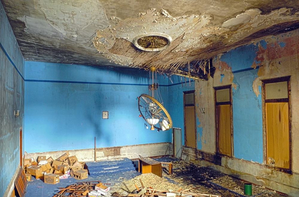 DETERIORATION: A roof beam can be seen cracking through the ceiling in the old Masonic Hall on Tuesday in Winthrop. Library director Richard Fortin said that the beam wasn't like that the last time he was in the building about a week ago. The hal is scheduled to be demolish to make room for a wing on the adjacent C.M. Bailey Public Library.
