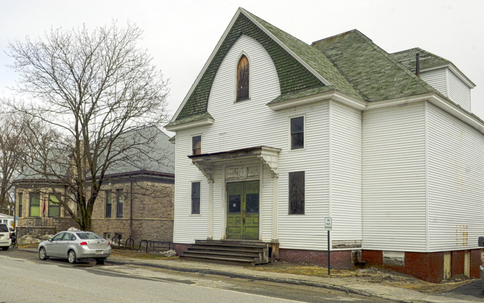 RIPE FOR EXPANSION: The C.M. Bailey Library, left, is shown next to the old Masonic Hall on Tuesday in Winthrop. The town plans to demolish the hall and add a wing on the adjacent Bailey Library.