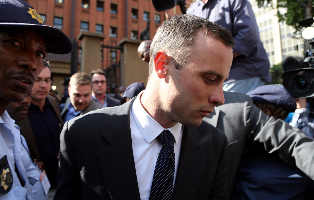 Oscar Pistorius leaves the high court in Pretoria, South Africa, on Tuesday. The Olympian is charged with premeditated murder in Reeva Steenkamp's death and faces a life sentence with a minimum of 25 years before parole if convicted on that charge.