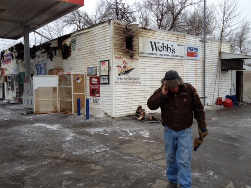 Rising from the ashes: Webb's Store owner Dan Kilmer, shown here shortly after the March 26 fire, said he hopes to rebuild by summer.