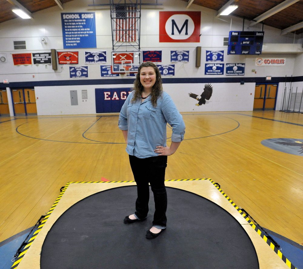 Staff photo by Michael G. Seamans Messalonskee High School sophomore, Emily Steinmeyer, 15, stands with her shot-put circle used for training during track practice at Messalonskee High School in Oakland.
