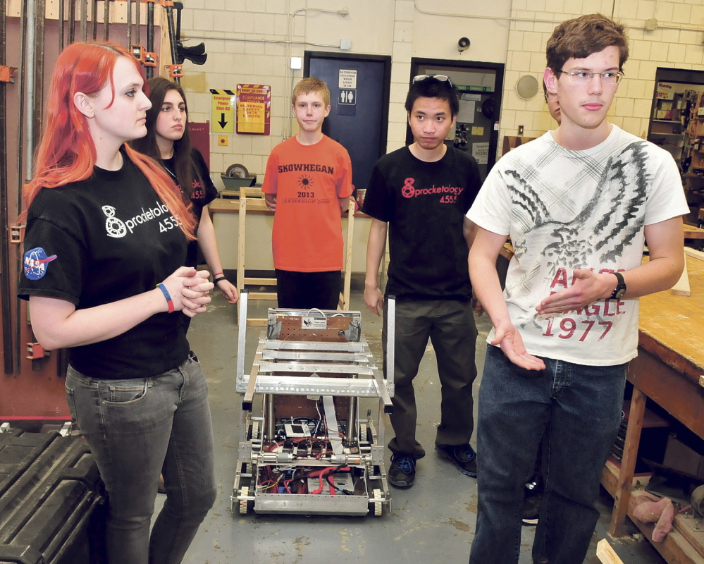 SILENT PARTNER: Members of the Skowhegan Area High School Sprocketology team including Samantha Wilkins, left, and Eben Lenfest.