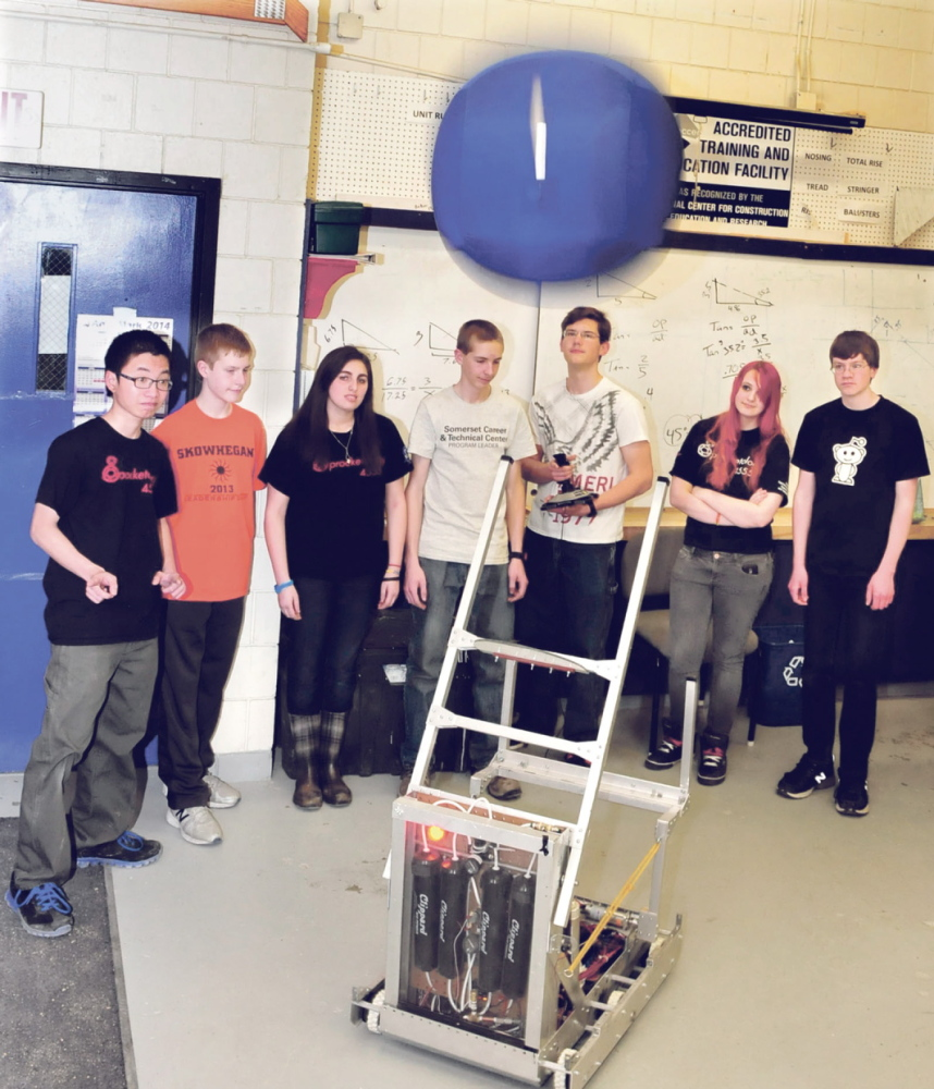 CATCH: Members of the Skowhegan Area High School Sprocketology team demonstrate how the robot the built named Spock can throw a ball.