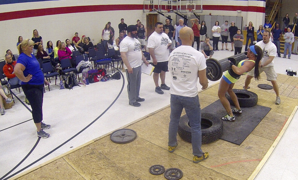 Strongman: Hollie MacKenzie wins the max log clean during the Central Maine Strongman 7 competition on Saturday at Augusta Armory. Increasingly heavier weights are added to the metal log each round until only one last competitor can lift it.