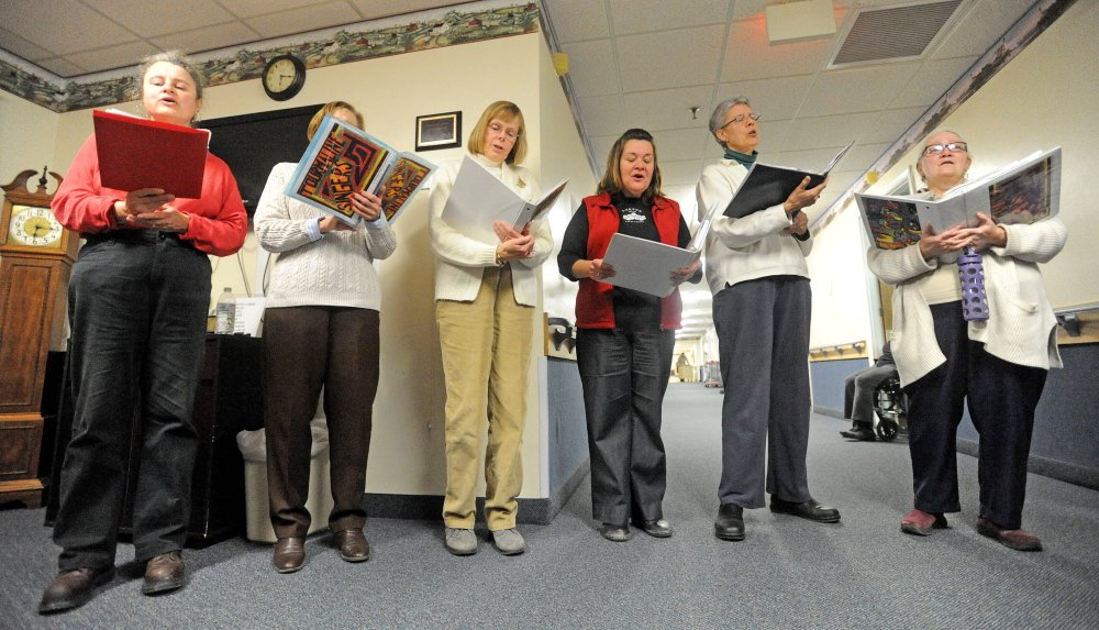 Lifting Spirits: The Tourmaline Singers perform for the staff and residents at the Augusta Center for Health and Rehabilitation.