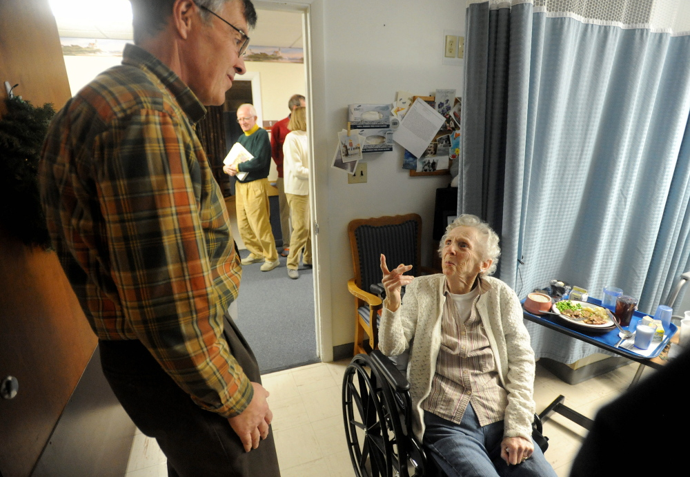 Rounds: Kay Squires talks with Harry Vayo of the Tourmaline Singers, as he makes the rounds to visit residents at the Augusta Center for Health and Rehabilitation.