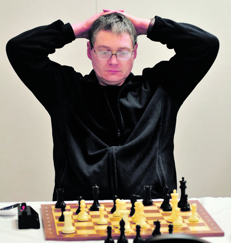 STUDY: Master chess player Jarod Bryan of Augusta studies his next move against player Mathew Fishbein of Cape Elizabeth two hours into the final match of the two-day Maine Closed Chess Championship in Waterville on Sunday.
