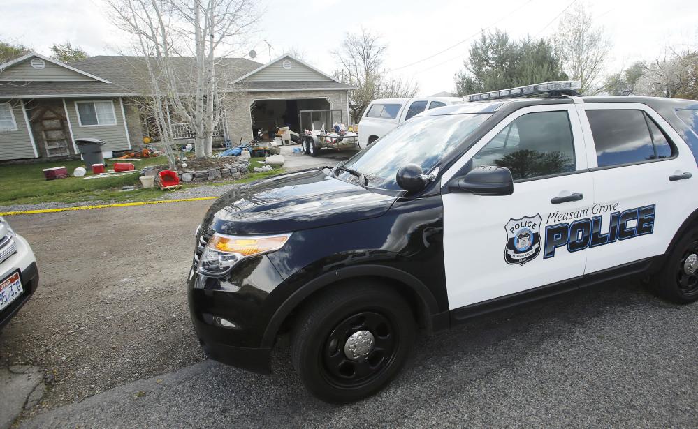 Pleasant Grove Police investigate the scene where seven infants' bodies were discovered Sunday.