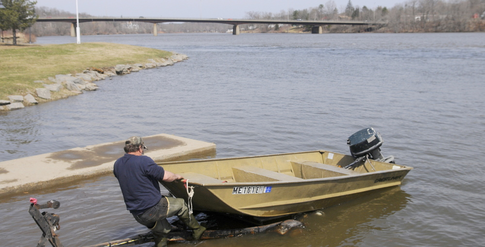 "Kevin Lemar of Belfast trailers his vessel Monday at the boat landing on the Kennebec River in Gardiner. Flooding is expected around the river this week because of warm temperatures and rainfall. Lemar, who was fishing for suckers, said conditions on the Kennebec were unpredictable. ""Year after year, it's always different,"" Lemar said."