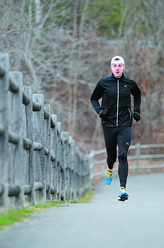 "BEFORE THE BOMBINGS: Seth Hasty runs on the Kennebec River Rail Trail in Gardiner last year, three days before he ran in the Boston Marathon. Hasty had finished the race and was at dinner when the bombs went off last year. He is running again this year. On the anniversary of the bombing Tuesday, he said that after last year, ""I couldn't wait to sign up."""