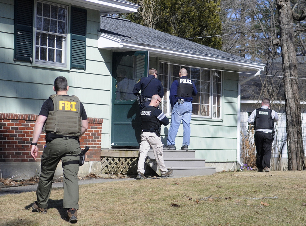 SEARCH FOR EVIDENCE: An FBI agent, Augusta Police and State Troopers with the Maine Computer Crimes Task Force on Thursday raid an Augusta residence where Gretchen Patrick, 51, was summoned on a charge of promoting sex trafficking. Police allege that Patrick operated Sarah's Place at a mobile home on Route 126 in Litchfield. Police raided the Augusta home and the trailer simultaneously in mid-afternoon.