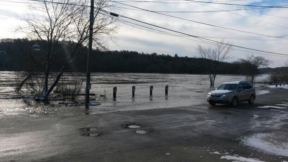RIVERBANK VANISHES: Floodwater covers Front Street in Hallowell on Wednesday morning.