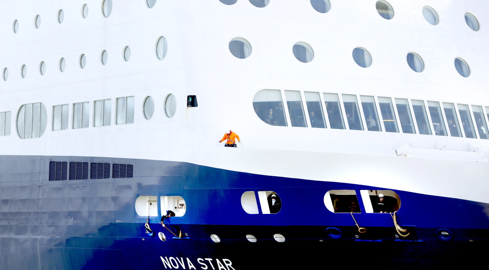 Workers on the Nova Star secure the lines in preparation for docking at Portland's Ocean Gateway Terminal, where the ship will be inspected by the Coast Guard.