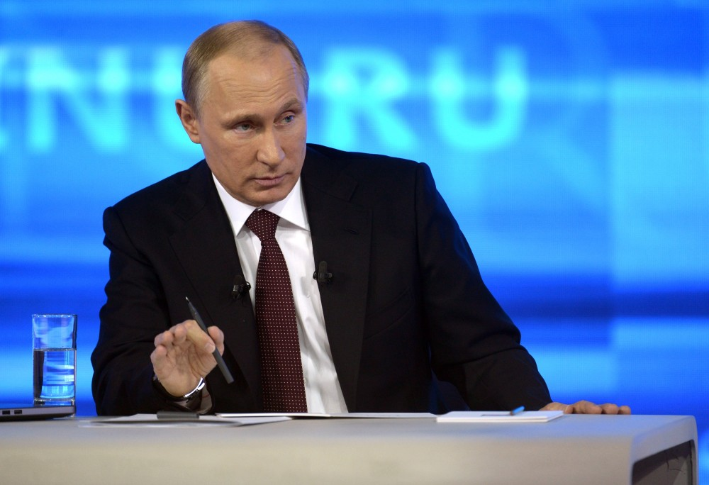 Russian President Vladimir Putin speaks during a nationally televised question-and-answer session in Moscow on Thursday. Putin has urged an end to the blockade of Moldovaís separatist province of Trans-Dniester. Trans-Dniester, located in eastern part of Moldova on border with Ukraine, has run its own affairs without international recognition since a 1992 war. Russian troops are stationed there.