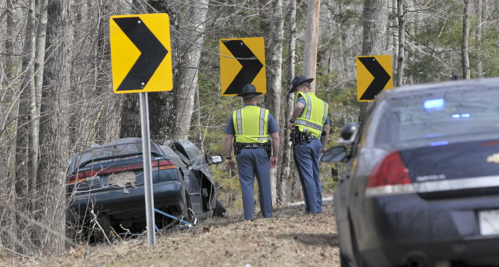 Fatal: Maine State Police troopers stand next the wreckage of a fatal car accident on Stone Road in Vassalboro on Friday.