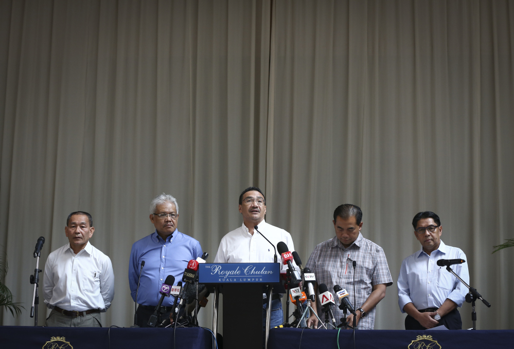 From left to right, Malaysia Airlines Group CEO Ahmad Jauhari Yahya, Deputy Minister of Foreign Affairs Hamzah Zainudin, Malaysia's acting Transport Minister Hishammuddin Hussein, third from left, Deputy Minister, Abdul Aziz Kaprawi and Malaysian Department of Civil Aviation, Azharuddin Abdul Rahman attend a press conference for the missing Malaysia Airline, MH370 at a hotel in Kuala Lumpur, Malaysia, Saturday.