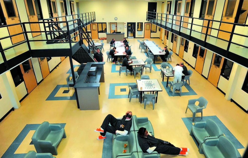 Jail accord: Inmates read and play board games in the day room in the medium security wing at the Somerset County Jail in East Madison.