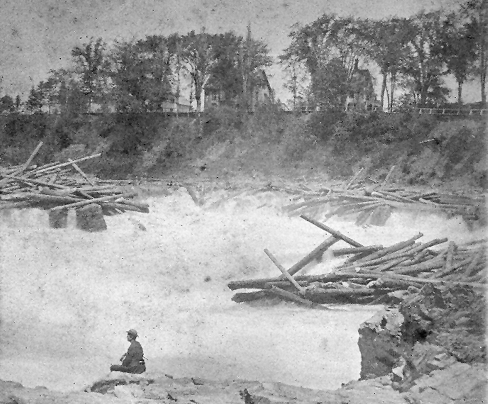 THE FALLS: An observer at Skowhegan Falls during a log drive around 1890.