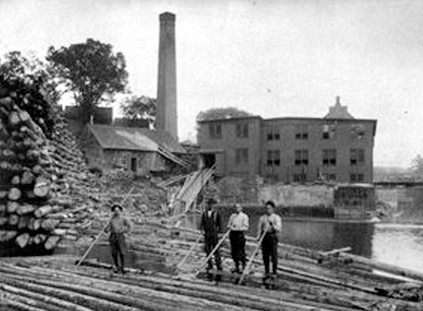 LOG WORK: Log drives at Skowhegan Pulp Company at Skowhegan Falls around 1900.