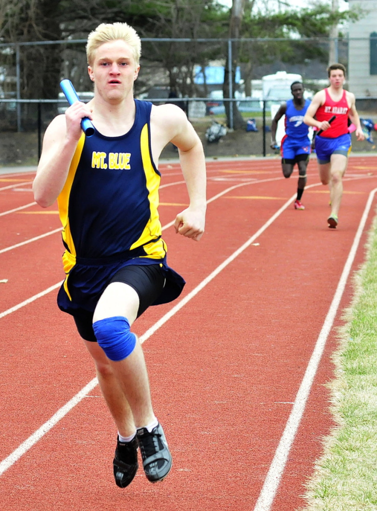 Staff photo by David Leaming Mt. Blue's Nate Backus leads in the distance medley race during a track meet in Waterville on Thursday, April 24, 2014.