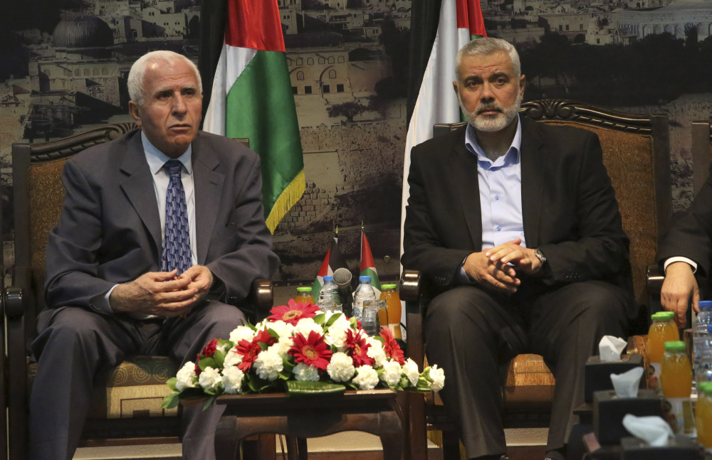 Gaza's Hamas Prime Minister Ismail Haniyeh, right, and senior Fatah official Azzam al-Ahmad meet in Gaza for talks aimed at reaching a reconciliation agreement between the two rival Palestinian groups, Hamas and Fatah on Tuesday.