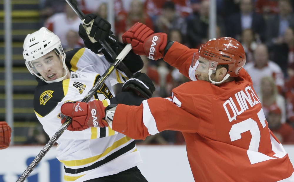 Detroit defenseman Kyle Quincey checks Boston right wing Reilly Smith in the first period Thursday.