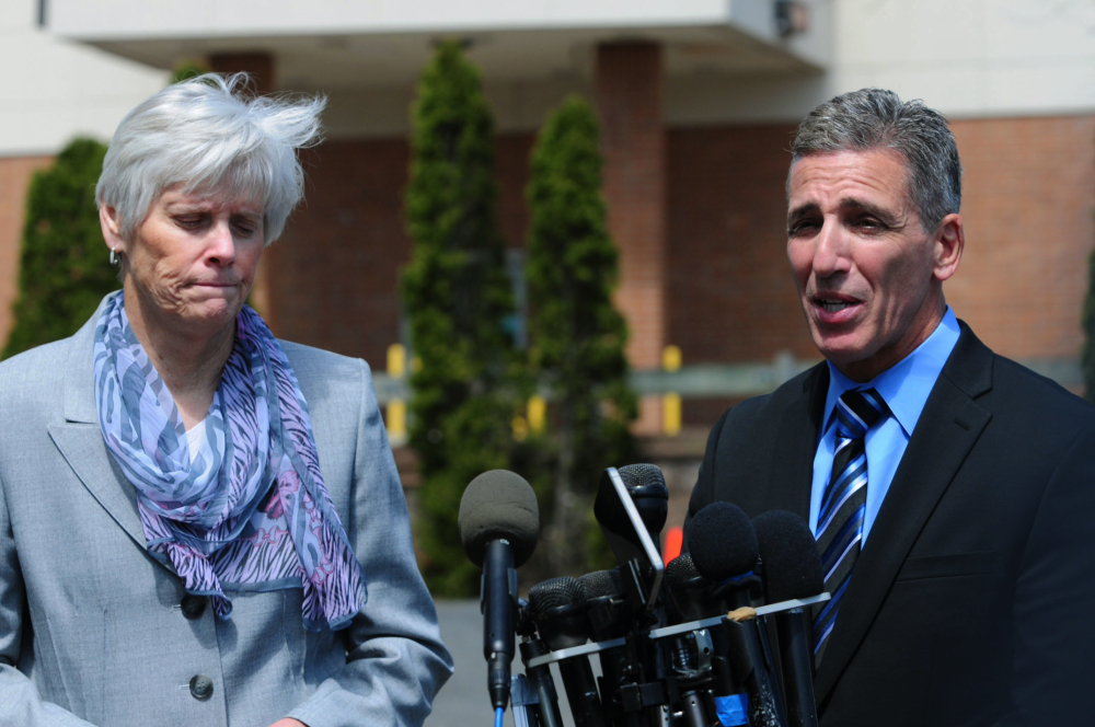 Milford Police Chief Keith Mello, right, speaks while Schools Superintendent Elizabeth Feser listens during a news conference at Jonathan Law High School in Milford, Conn., Friday.