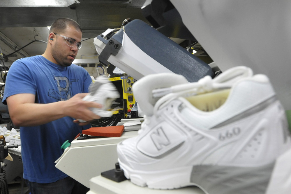 An employee puts soles on shoes at the New Balance factory in Norridgewock. The Pentagon on Friday took a step toward supplying new recruits with American-made sneakers, a move that could create a windfall for New Balance.