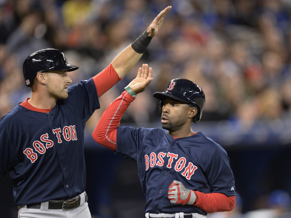 Will Middlebrooks, back from the disabled list, celebrates with Jackie Bradley Jr. after they scored on a single by Dustin Pedroia in the second inning.