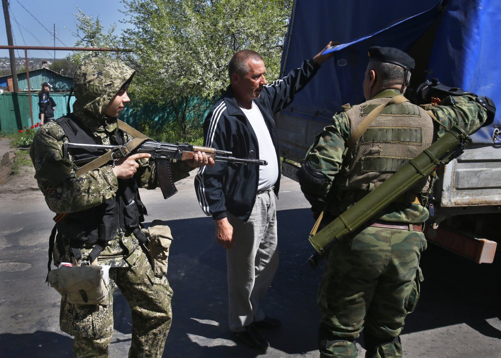 Pro-Russian armed militants inspect a truck near Slovyansk, eastern Ukraine, on Friday. Russian Foreign Minister Sergey Lavrov has accused the West of plotting to control Ukraine.