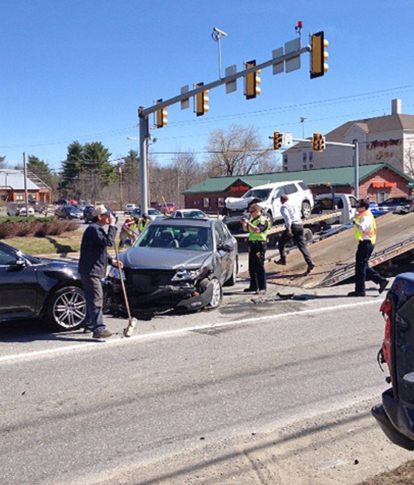Crash: Police attend to a four-vehicle accident Friday on Kennedy Memorial Drive in Waterville.