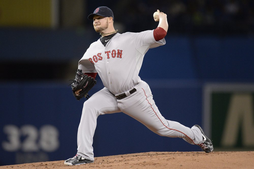Red Sox starting pitcher Jon Lester delivers to the Toronto Blue Jays in the first inning in Toronto on Sunday.