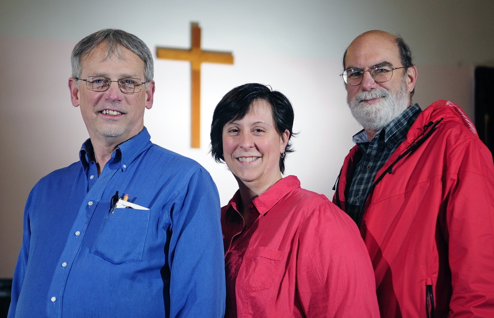 Team leaders: From left, the Rev. Gary York, pastor of Oakland United Baptist Church; Emily Webber, a trustee of Dunn's Corner Baptist Church in Mount Vernon; and Ted Chaffee, pastor of Gardiner First Baptist Church, pose on Thursday in Readfield. They're organizing another mission trip to the Lower 9th Ward of New Orleans in August.