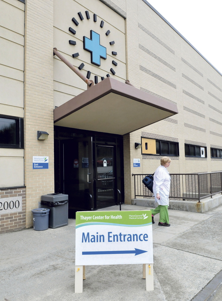 TEMPORARY: Thayer Center for Health employee Bonnie Dubois leaves the temporary entrance to the Waterville hospital on Monday. The entrance is at the rear and center of the hospital and should be used during the renovation project.