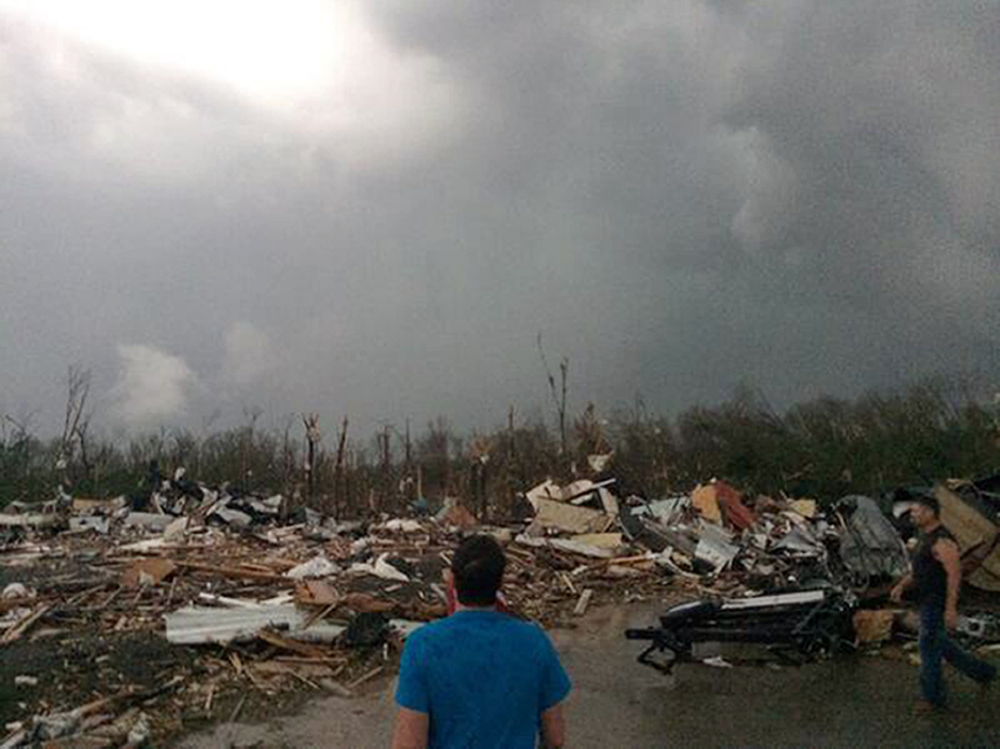 This photo provided by James Bryant shows damage from Sunday's tornado in Mayflower, Ark. The Arkansas twister shredded cars, trucks and 18-wheelers stuck along Interstate 40 north of Little Rock.