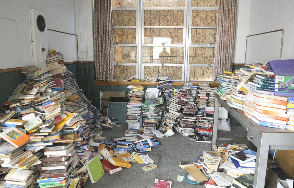 RELICS OF THE PAST: Textbooks are stacked up Tuesday in the office of the former Hodgkins Middle School in Augusta.