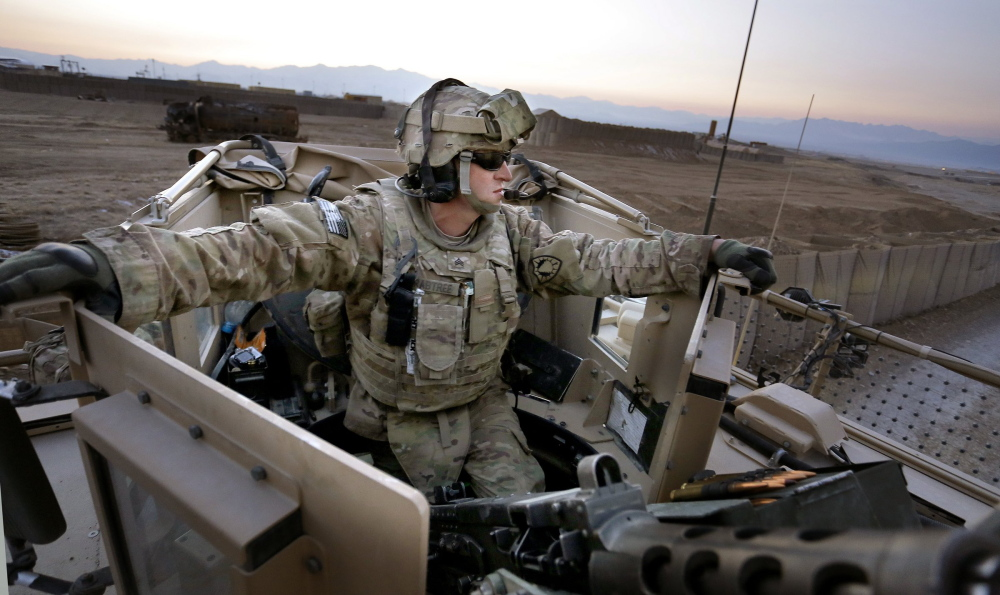 Sgt. Eric Crabtree of Hope, a gunner with a Convoy Escort Team of the 133rd Engineer Battalion of the Maine Army National Guard, rides in the gun turret during tests before departing on a convoy to Bagram Air Field in Afghanistan last winter.