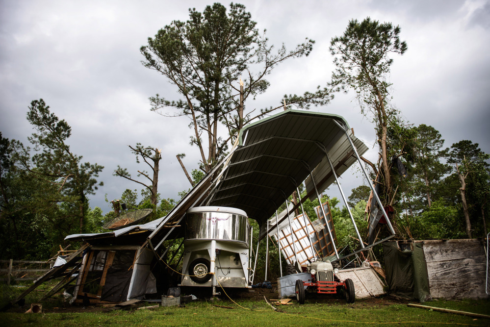 Larry Smith's camper shelter near Stedman, N.C., was destroyed after a possible tornado passed by his house Tuesday. At least five counties in eastern North Carolina reported tornadoes on Tuesday.