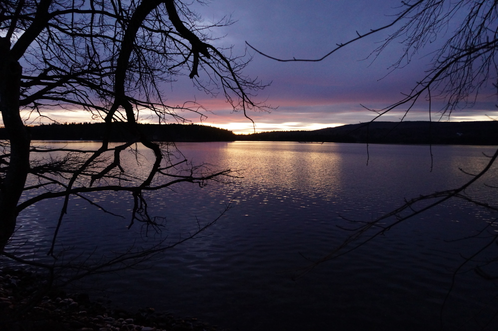 SILENTLY IMPAIRED: It's hard to believe Long Pond — seen here at sunset from Belgrade Lakes village — is an impaired lake, but it's deteriorating and local groups are talking about ways to stop the damage.