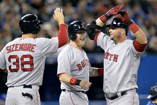 Boston's A.J. Pierzynski, right, is congratulated by Mike Carp, center, and Grady Sizemore after hitting a grand slam during the third inning against the Blue Jays in Toronto on Saturday. Blue Jays;athlete;athletes;athletic;athletics;Canada;Canadian;Center;Centre;competative;compete;competing;competition;competitions;event;game;Jays;League;Major;MLB;pro;professional;Rogers;sport;sporting;sports;Toronto;baseball;American;AL;2014