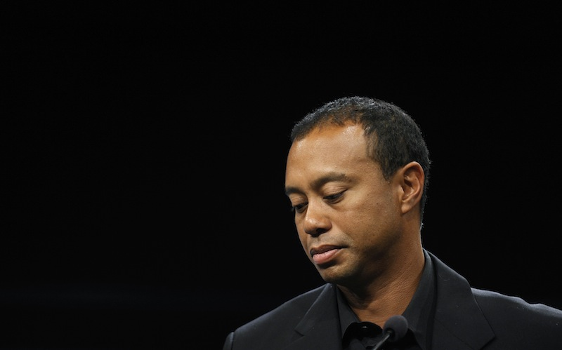 Tiger Woods, seen here last month, will miss the Masters for the first time in his career after having surgery for a pinched nerve in his back.