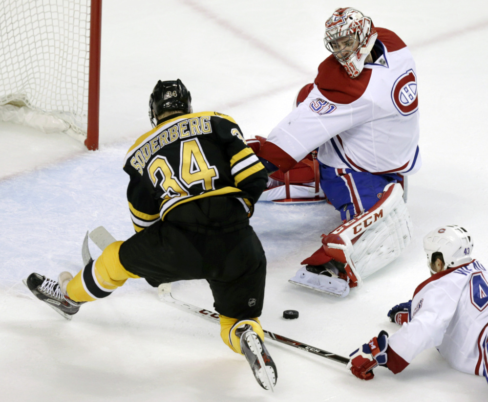 Montreal Canadiens goalie Carey Price reaches back to make a save on a shot by Boston Bruins center Carl Soderberg during the second period Thursday.