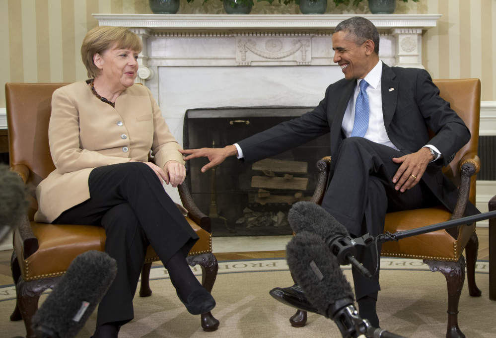 President Barack Obama meets with German Chancellor Angela Merkel in the Oval Office Friday. Merkel, like Obama, has ruled out military action to deter Vladimir Putin from seizing more of Ukraine.