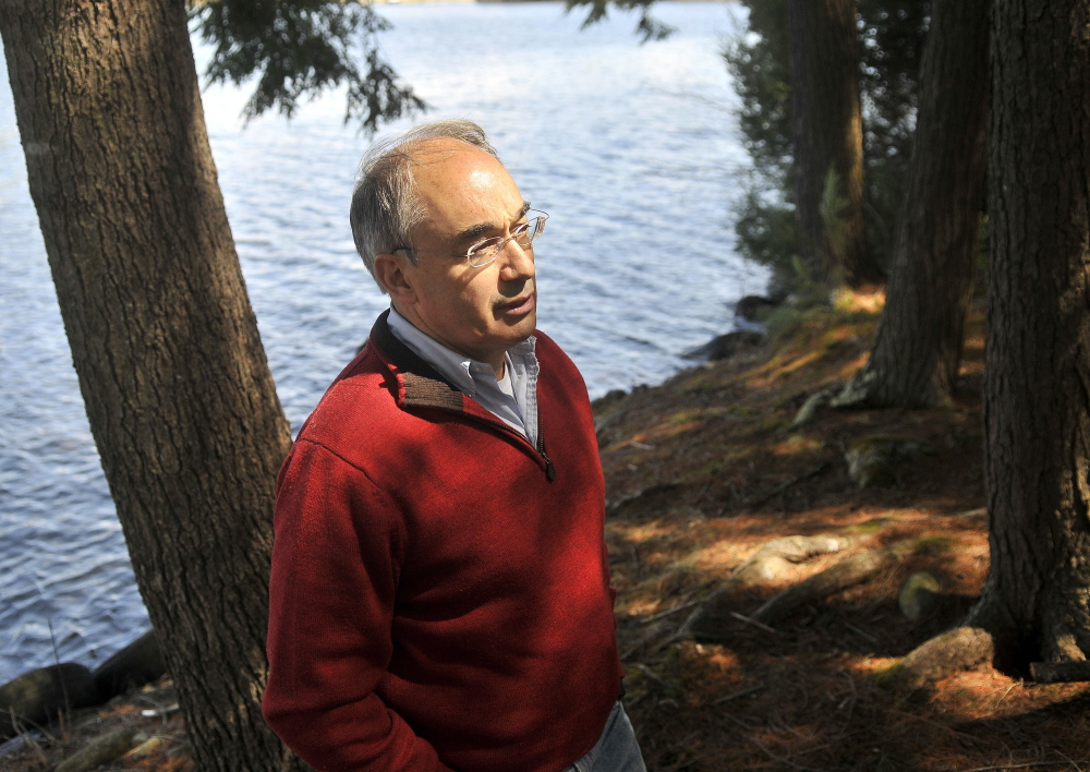Connections: Bruce Poliquin, a candidate for the Republican nomination for the 2nd Congressional District seat, talks about his connection to Oakland and Waterville on Friday from the banks of his family property on Messalonskee Lake in Oakland.
