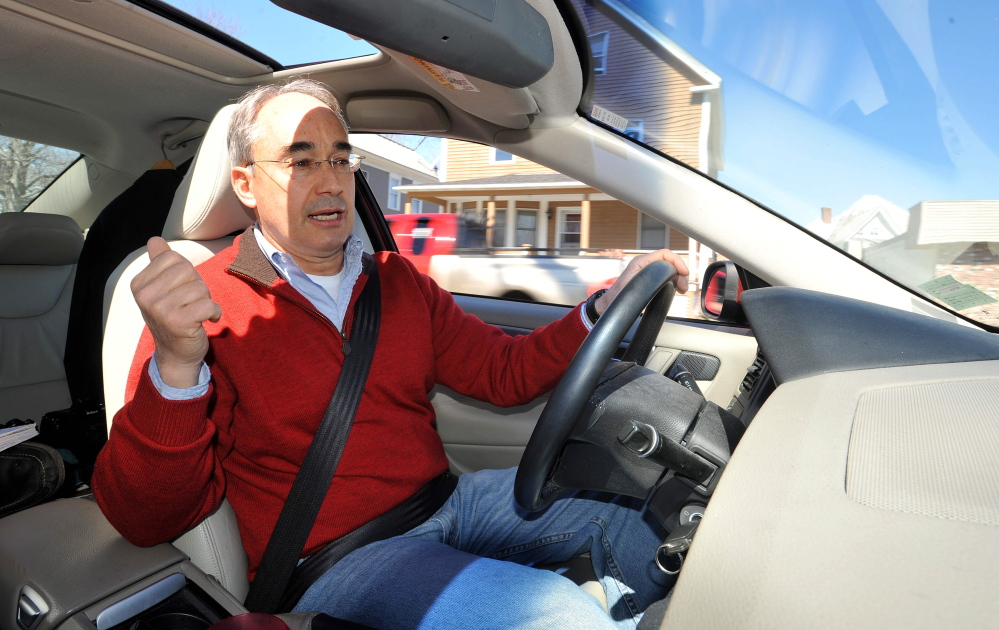 Childhood: Bruce Poliquin, a candidate running for the Republican nomination for the 2nd Congressional District seat, drives through his childhood neighborhood on Violette Street in Waterville on Friday.
