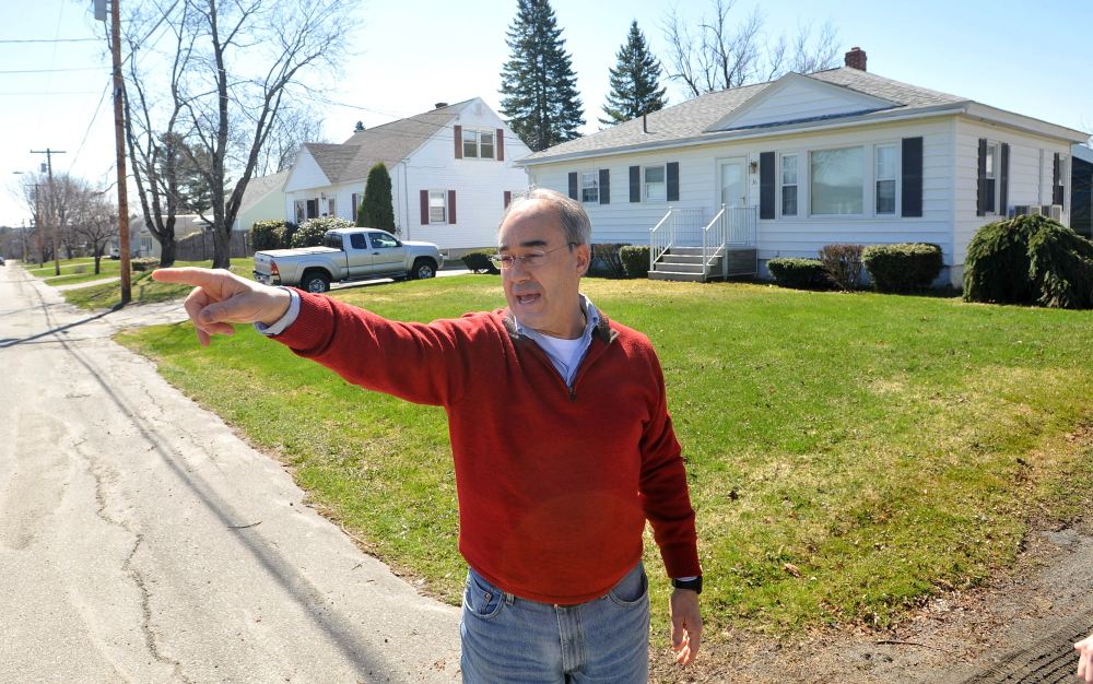 OLD HOME: Bruce Poliquin, a candidate for the Republican nomination for the 2nd Congressional District seat, stands in front of his childhood home on Violette Avenue in Waterville on Friday.
