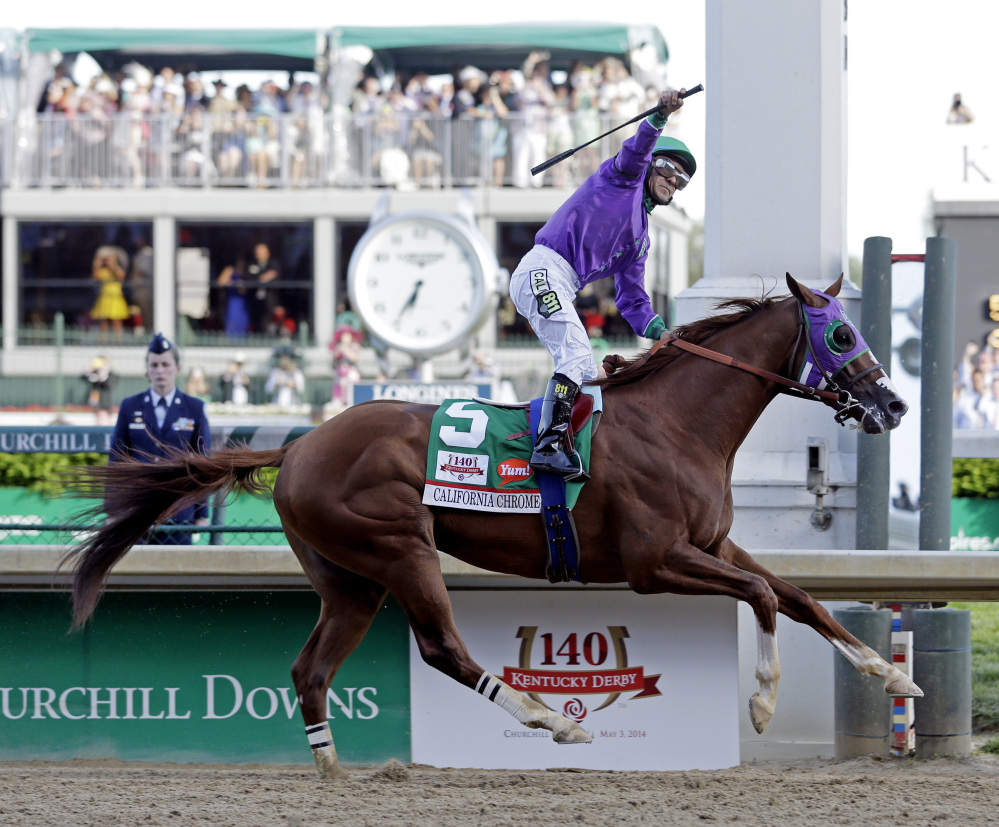 Victor Espinoza rides California Chrome to a victory during the 140th running of the Kentucky Derby horse race at Churchill Downs Saturday, in Louisville, Ky.